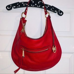 Vibrant bright RED authentic MK hobo style purse.